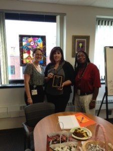 Dr. Megan Callanan presenting the 2013 Advocacy Award to Shye Louis, Manager and Sherika Hall, Operations Supervisor at 2-1-1/LIFE LINE